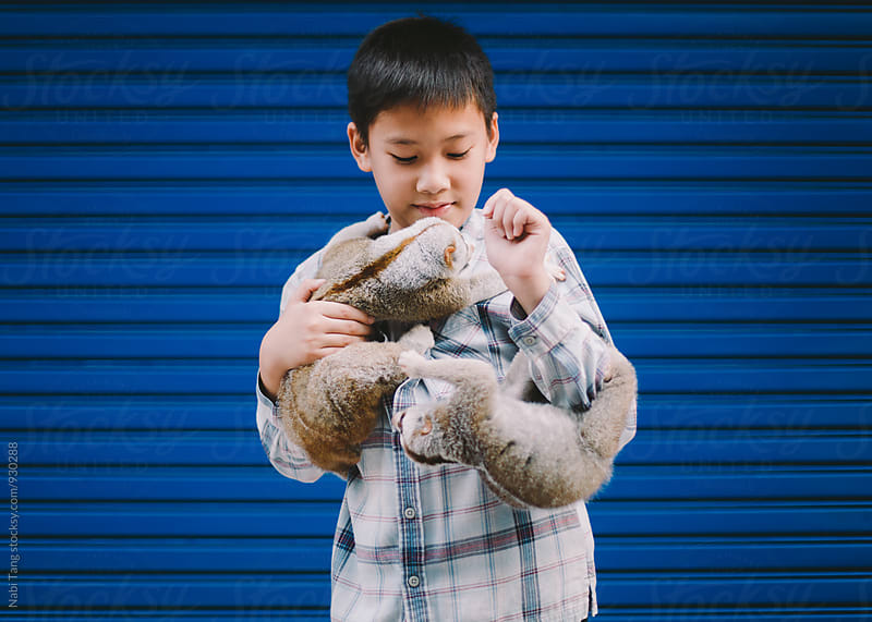Boy with his pets by Nabi Tang for Stocksy United