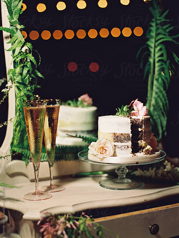 nighttime wedding cake picture with lights by wendy laurel for Stocksy United