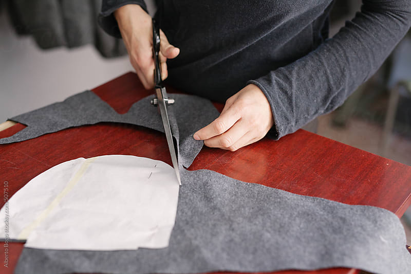 Young Tailor is Working in atelier by Alberto Bogo for Stocksy United