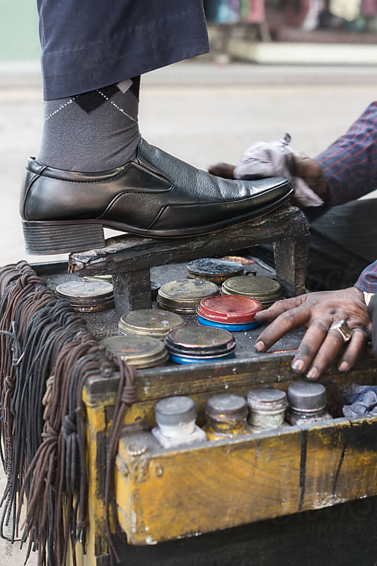 Shoe Shiner working by RG&B Images for Stocksy United