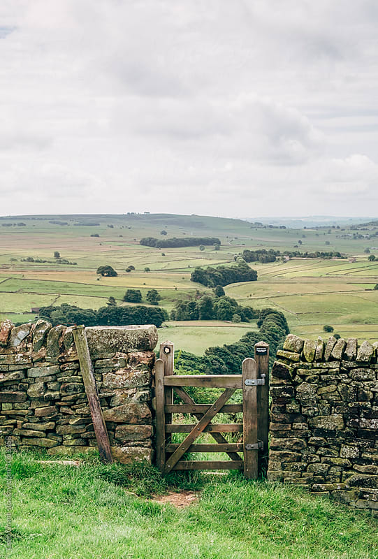 Gate in a wall leading to the next valley. Derbyshire, UK. by Liam Grant for Stocksy United