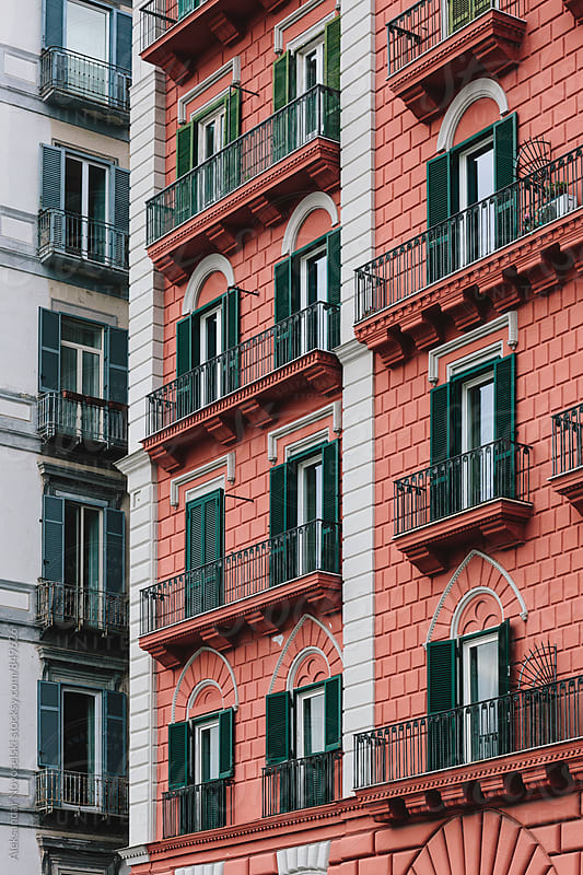 Red building in Naples, Italy by Aleksandar Novoselski for Stocksy United