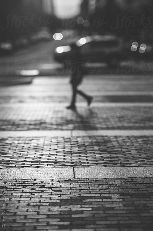Silhouette and shadow of a girl walking in the city.  by Cameron Whitman for Stocksy United