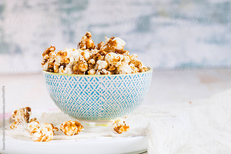 Salted caramel popcorn by Susan Brooks-Dammann for Stocksy United