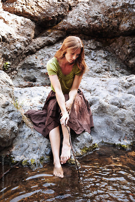 Beautiful redhead woman relaxing in nature in California  by Trinette Reed for Stocksy United