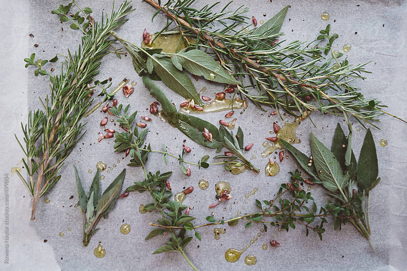 Fresh Herbs ready for roasting with vegetables by Rowena Naylor for Stocksy United