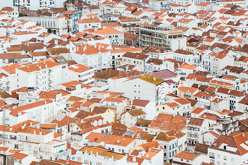 Aerial city view of white houses with orange tiled roofs in typical village by Alejandro Moreno de Carlos for Stocksy United