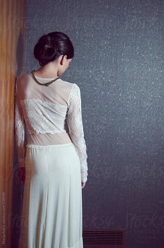 Beautiful brunette bride in white wedding dress ,indoor by Marija Anicic for Stocksy United