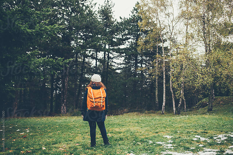Woman With a Backpack on the Edge of a Forest by Lumina for Stocksy United