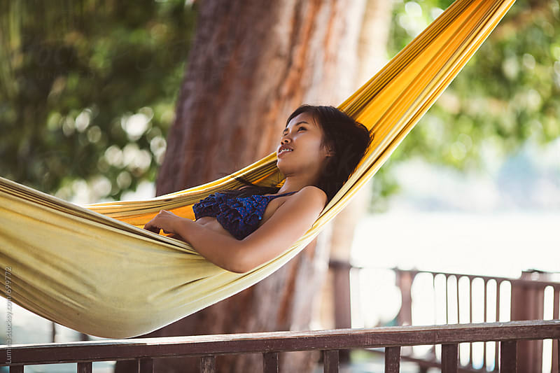Asian Woman Lying in a Hammock at the Beach by Lumina for Stocksy United