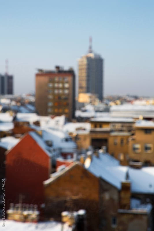 city at winter in blur by Sonja Lekovic for Stocksy United