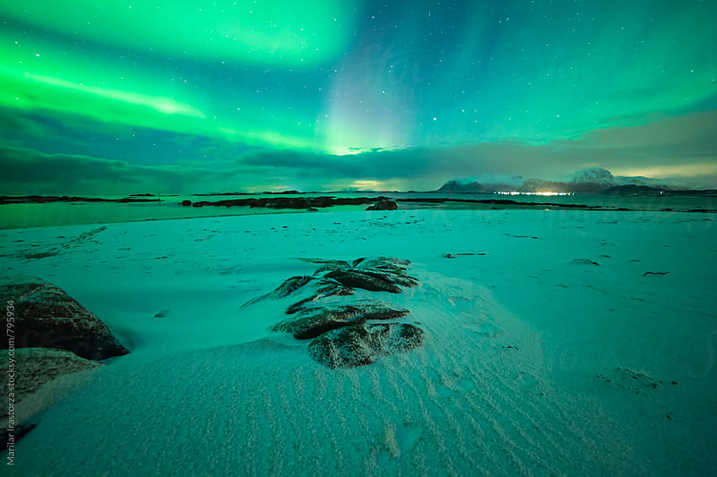 Northern Lights on a Norwegian beach by Marilar Irastorza for Stocksy United