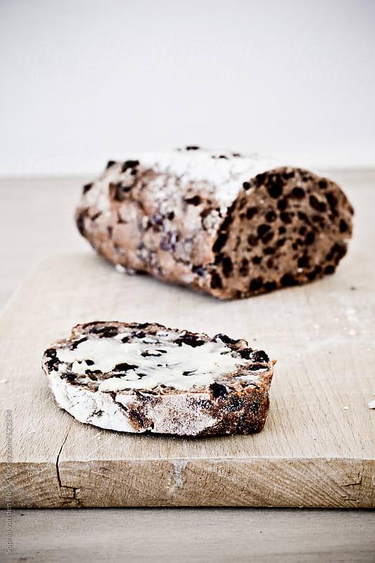 Currant bread with butter by Sophia van den Hoek for Stocksy United