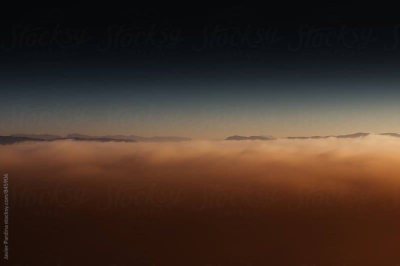 landscape with clouds at sunset  by Javier Pardina for Stocksy United