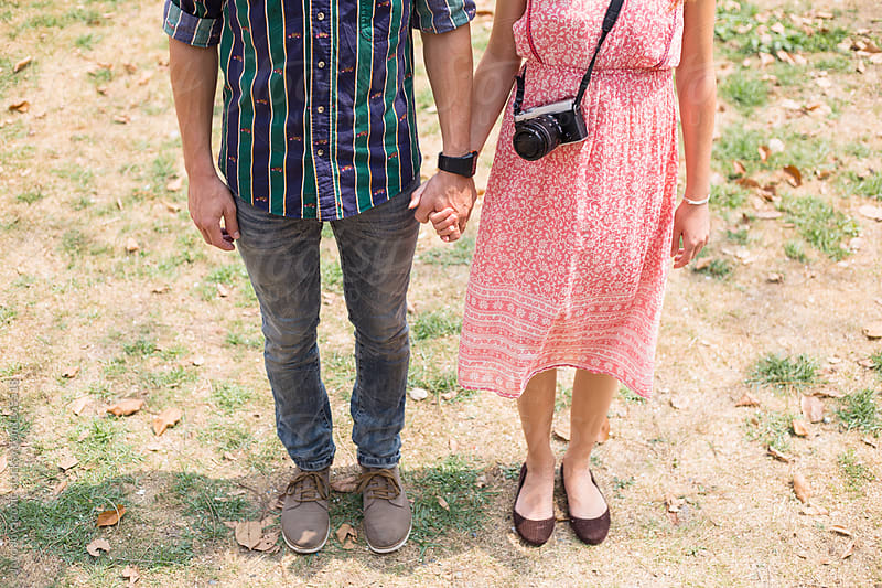 Romantic couple holding hands by Jovo Jovanovic for Stocksy United