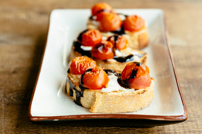 Roasted Cherry Tomato Crostinni by Harald Walker for Stocksy United