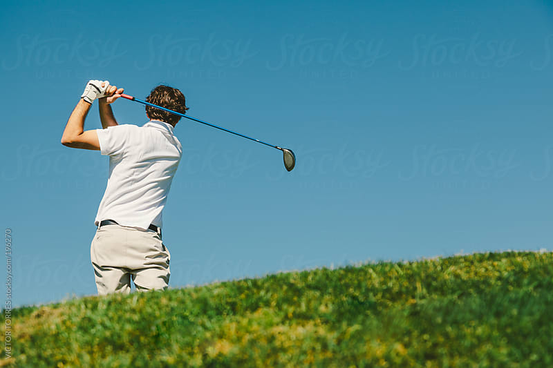 golfer playing off the tee box by VICTOR TORRES for Stocksy United