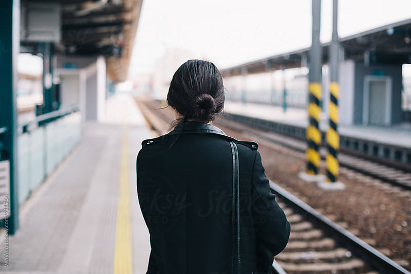 Woman waiting for the train by Marija Mandic for Stocksy United