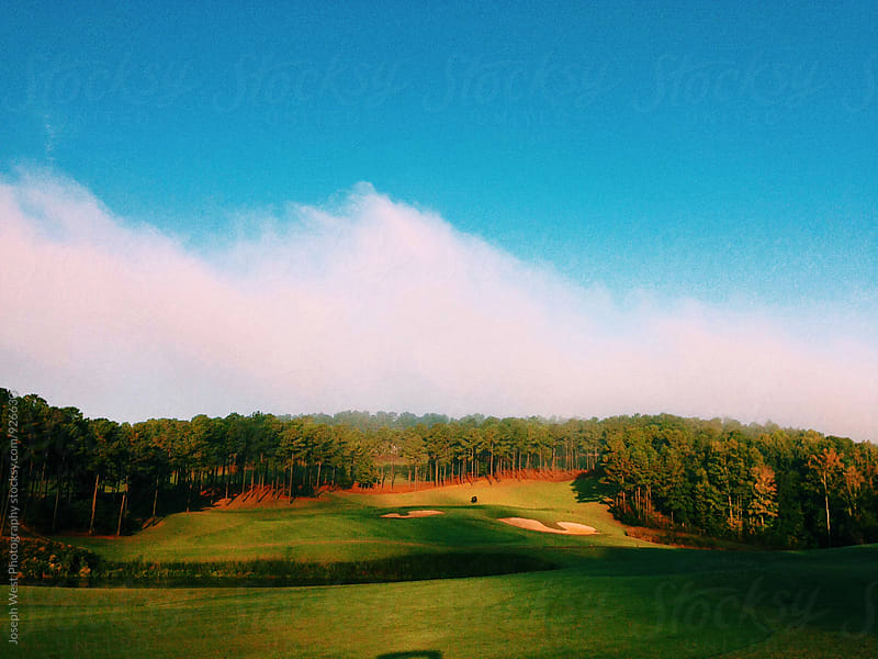 A golf course in the morning sun by Joseph West Photography for Stocksy United