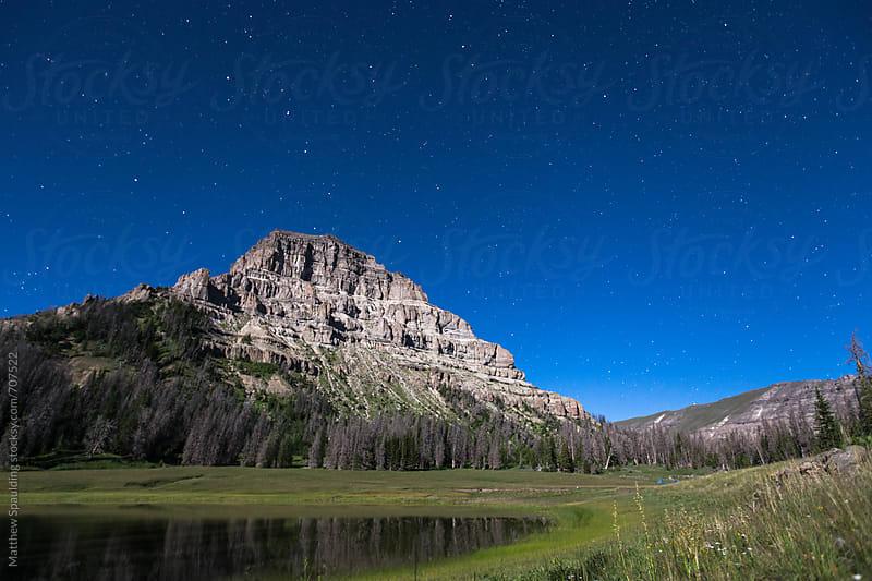 Moonlit mountain under stars by Matthew Spaulding for Stocksy United