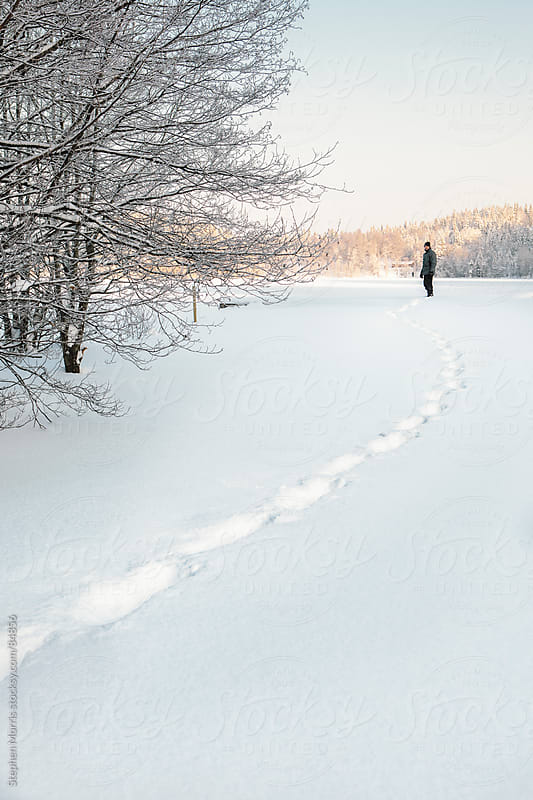 Man Leaving Tracks in Snow by Stephen Morris for Stocksy United