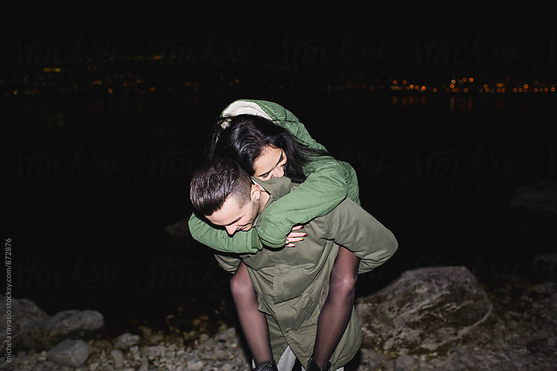 Young teenage couple having fun together at night by michela ravasio for Stocksy United