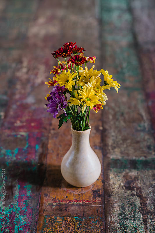 Flowers In  Ceramic Vase On Old Table by Alexander Grabchilev for Stocksy United