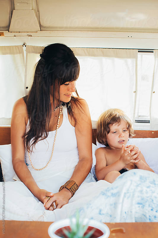 On The Road - Latin Mother Sitting With Young Boy in Stylish White Camper Van by Julien L. Balmer for Stocksy United