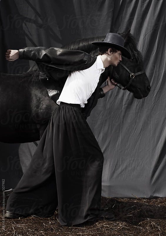 Young man posing with horse by Danil Nevsky for Stocksy United