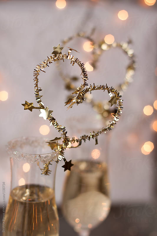 2 glasses of Champagne for celebration with heart shape decoration by Beatrix Boros for Stocksy United
