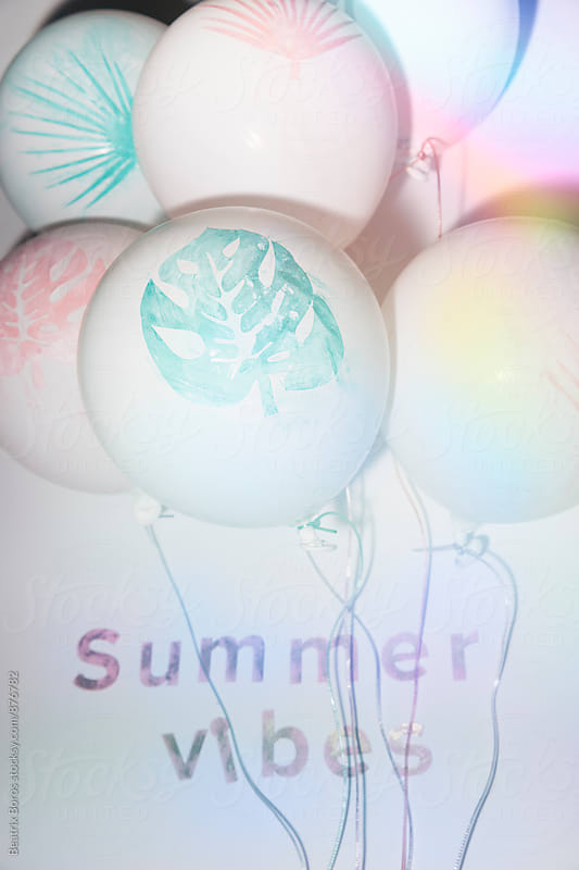 Festive balloons with colorful light by Beatrix Boros for Stocksy United