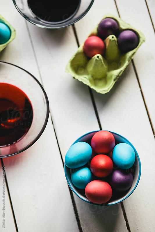 Painting Easter eggs on white background by Aleksandar Novoselski for Stocksy United