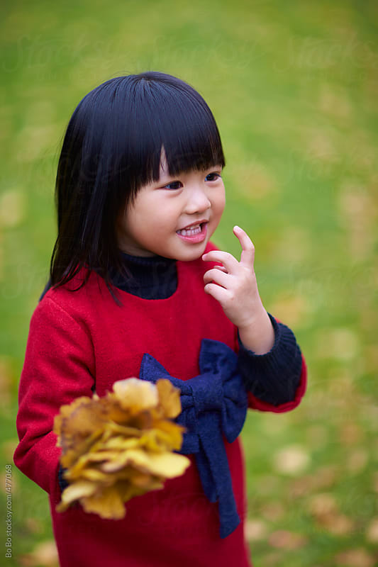one little asian girl outdoor in the park by Bo Bo for Stocksy United