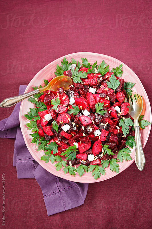 Beetroot salad with feta cheese, pine nuts, olive oil, parsley and black cumin seeds by Elisabeth Coelfen for Stocksy United