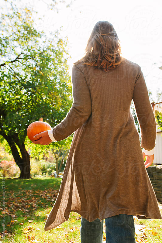 Woman with Pumpkin in Autumn Season by Raymond Forbes LLC for Stocksy United
