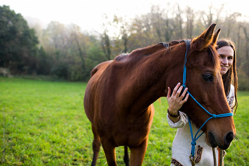 Woman and her affectionate horse in the nature by michela ravasio for Stocksy United
