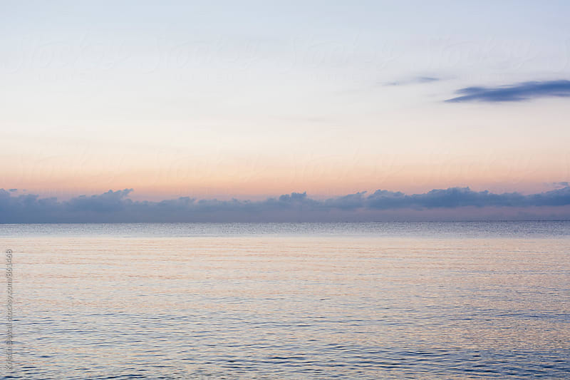 Ocean and horizon at sunrise. Florida. by Kristin Duvall for Stocksy United