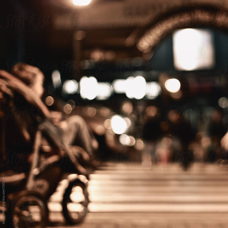 A child in a pram at night by Jacqui Miller for Stocksy United