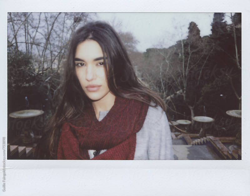 polaroid of brunette wearing a scarf by Guille Faingold for Stocksy United
