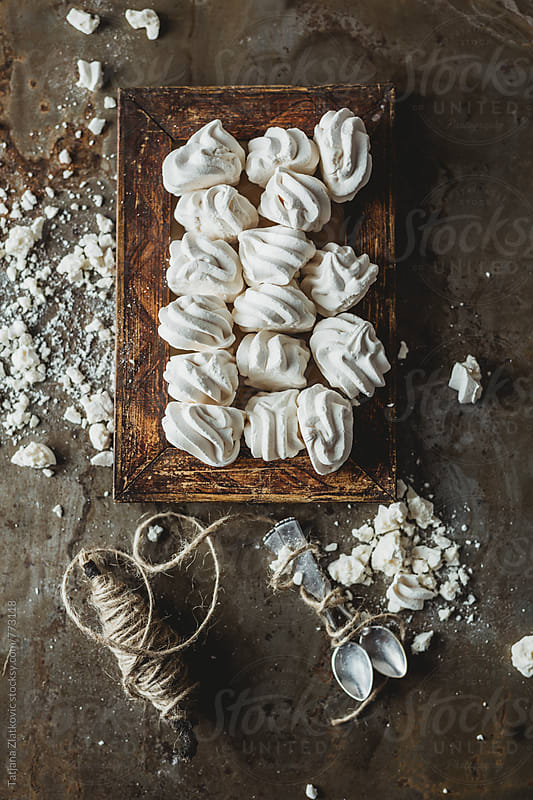 Wooden frame with meringue kisses by Tatjana Ristanic for Stocksy United