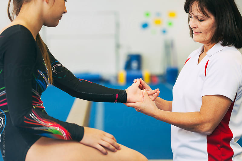 Gymnastics: Teen Hurts Hand While Doing Beam Routine by Sean Locke for Stocksy United