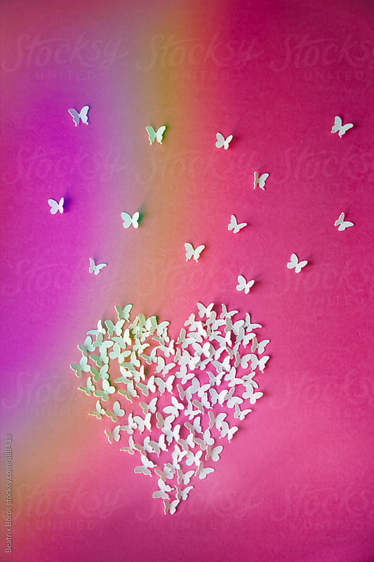 Heart, flying butterflies and rainbow reflection by Beatrix Boros for Stocksy United