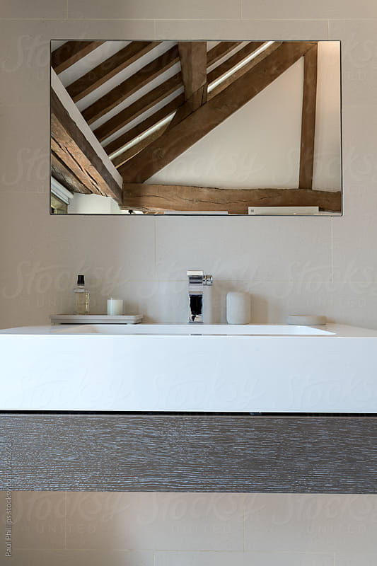 Contemporary bathroom fittings in an old timber frame building by Paul Phillips for Stocksy United