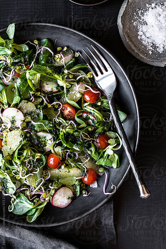 Lamb's lettuce salad with radish, tomatoes and coriander vinaigrette by KEMA Food Culture for Stocksy United