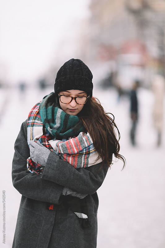 winter portrait on the street by Alexey Kuzma for Stocksy United