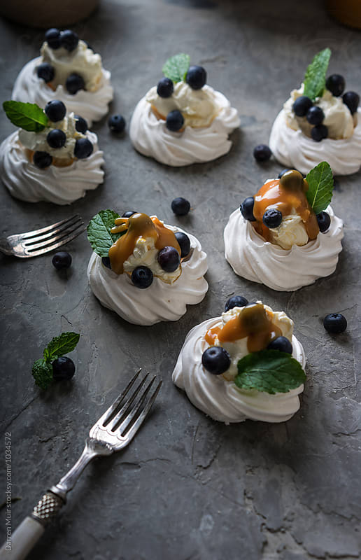 Blueberry pavlovas. by Darren Muir for Stocksy United