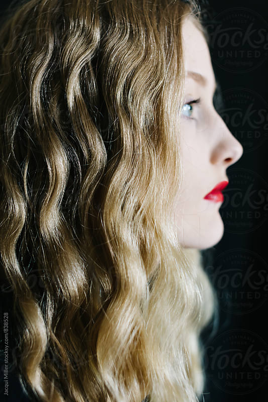 Side profile of Teen Girl with Long Blonde Hair and Red Lipstick - focus on hair by Jacqui Miller for Stocksy United