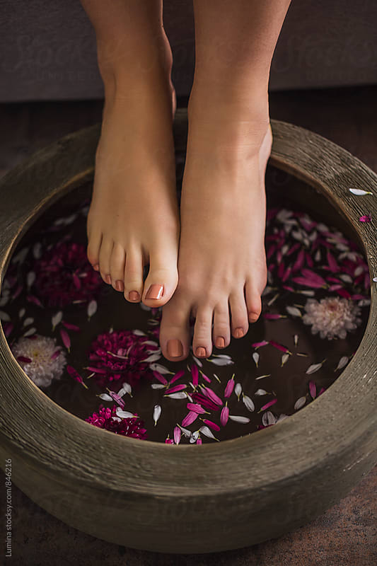 Legs of a Woman Having a Relaxing Flower Bath by Lumina for Stocksy United