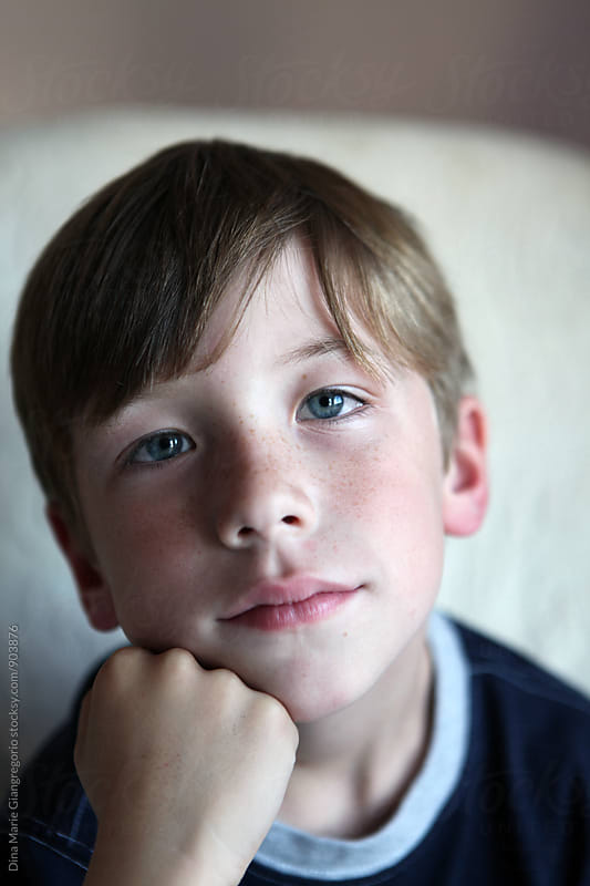Portrait of boy with Freckles by Dina Giangregorio for Stocksy United