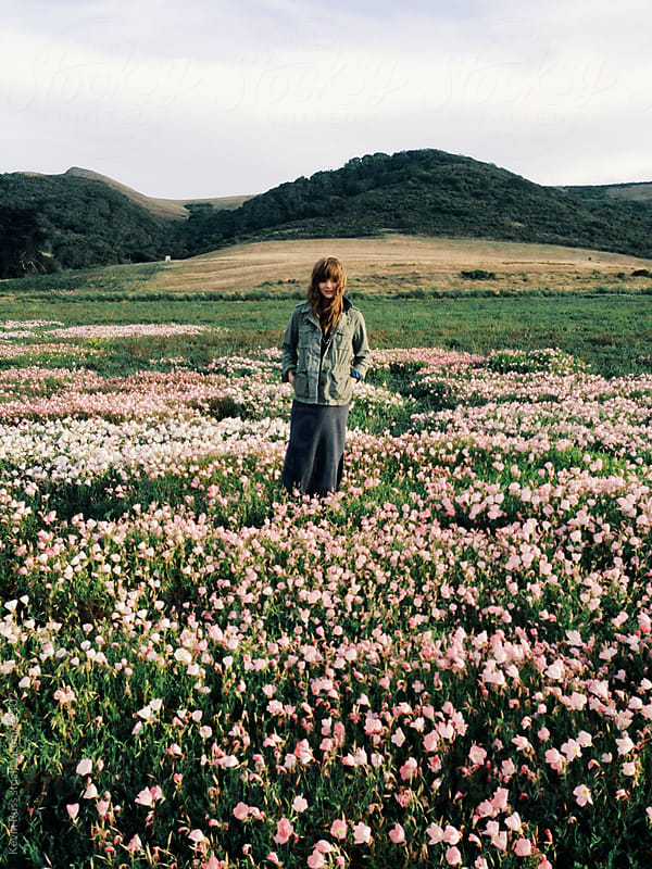 Woman Standing in Wild Flower Field by Kevin Russ for Stocksy United